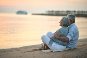 Portrait,Of,A,Senior,Couple,At,Sea,At,Sunset